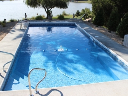 Geometric Vinyl Liner Pool With Side Steps and Fountain